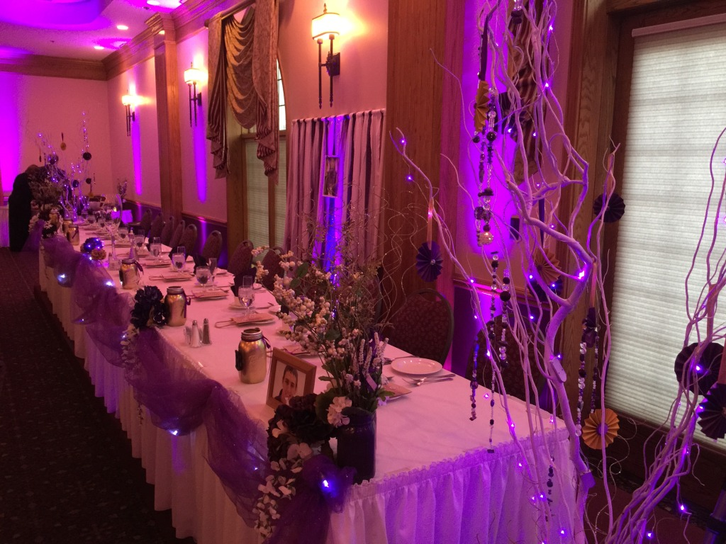 head table with purple uplights-rent Michigan uplighting