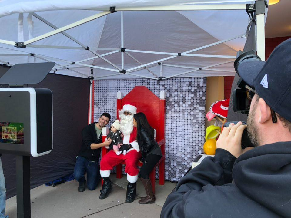 Santa taking photos at Holiday Party Photo booth for rent in westland michigan