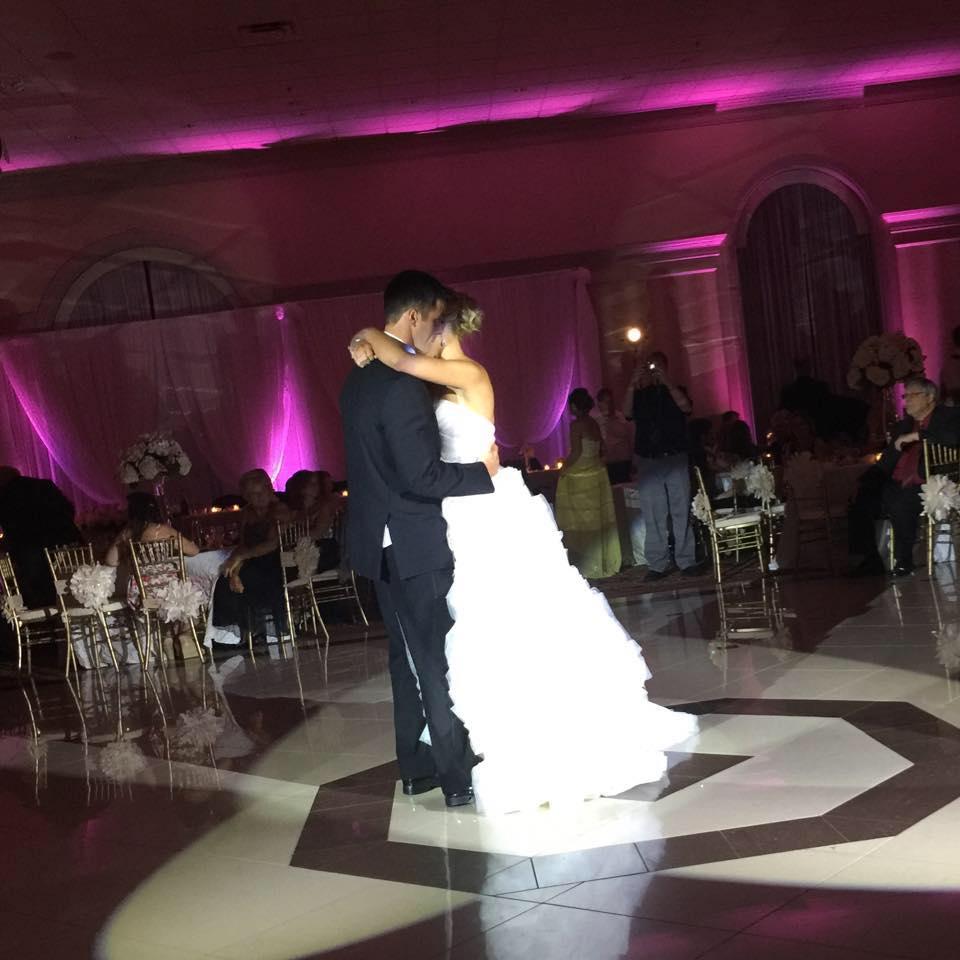 Bride and groom dancing in the spotlight during first dance with uplighting in detroit MI- Detroit wedding DJs